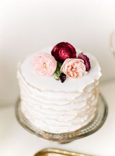 Ruffle cake with flowers | Inspiration Board: Each Peach Pear Plum | SouthBound Bride | http://www.southboundbride.com/inspiration-board-each-peach-pear-plum | Credit: Kina Wicks