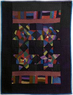 """Rare Amish wool crib quilt with pieced stars, blocks, and bars in various colors, 44 1/2"""" x 34"""".  Pook & Pook auction house."""