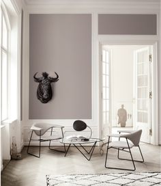 Luxuriate in the Living Room. Grey walls, Gubi chairs, and a black and white beni ourain rug.