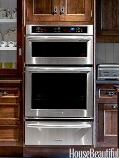 A combination microwave and wall oven is paired with a warming drawer, all by KitchenAid from the Architect Series II.