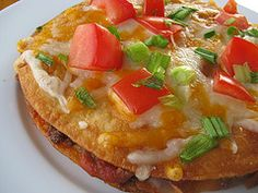 1lb ground beef  1 (1 ¼ ounce) package taco seasoning  8 small flour tortillas  2 tablespoons water  1 (16 ounce) can refried beans  2/3 cup mild salsa  2 cups Colby jack cheese  ¼ cup tomato (diced)  ¼ cup green onion (chopped)  oil (for frying)  Fry tortillas  Assmeble as desired  Bake on 400 degrees for 8 minutes.