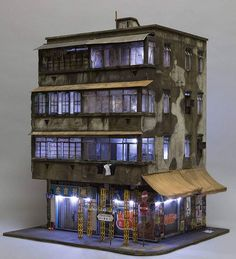 3/4 (nighttime version) of my completed Hong Kong miniature based on 23 Temple Street in Kowloon for the VOLTA Art fair in NYC showing with Muriel Guipen gallery of Manhattan @murielguepingallery. Featuring the work of Yumoh and Xeme @_n.hkg @xememex Check it out on display at Muriel Guipen gallery stand at the VOLTA Art fair, Pier 90 in Manhattan running from March 1-5. Photo credit: Andrew Beveridge/ASB creative. All fully scratchbuilt at 1:20 scale by joshua_smith_street_artist