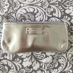 Michael Kors Silver Mini Clutch Beautiful silver Michael Kors mini clutch/make up bag. 3' by 7' inches. Perfect condition. Bags Clutches & Wristlets