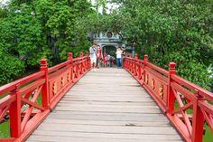 Walk across the red bridge to Hoan Kiem Lake