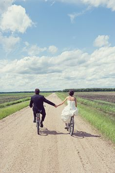 Not so much on the bikes... nor in wedding gear, but walking hand in hand with beautiful blue skies down an old dirt road lined with fields