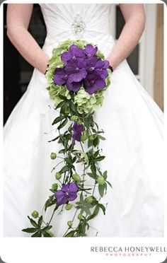 lovely purple cascading bouquet...  any flowers are great when cascading
