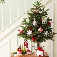 Use a vintage trophy cup in to hold a tiny Christmas tree!