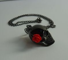 Black skull with red rose necklace black by BlueBubbleCrystals