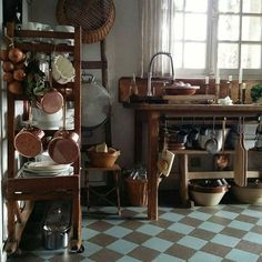 Rustic country kitchen in Europe with copper and checker floors. It's all about Beautiful European Country Kitchens today; some with English Country style, more with French Country style, others with Nordic appeal, and a few with… Rustic Kitchen Tables, Rustic Country Kitchens, Rustic Kitchen Design, Rustic Table, Vintage Kitchen, Kitchen Decor, Kitchen Ideas, Pine Kitchen, Eclectic Kitchen