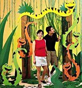 Snake Pit Entrance Entice guests into your wild party with this 8' x 5 1 / 2' cardboard and corrugated entrance. The self-standing arch doubles as a great photo setting! Snake Standee Liven up party corners and doorways with this 4' x 2' cardboard and corrugated self-standing reptile.