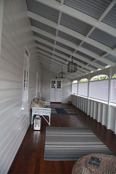 Queenslander home enclosed verandah Beautiful dark timber decking and white colours on the weatherboard of the home along with the white lattice screening the verandah. All complimented with grey colorbond roof. Just perfect for Australian conditions. Queenslander House, Weatherboard House, Outdoor Rooms, Indoor Outdoor, Outdoor Living, Style At Home, Colorbond Roof, Front Verandah, Front Porch