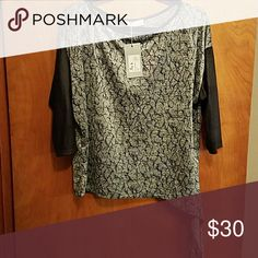 🔥SALE🔥Abstract Tie-Waste Top Silver and black crackle look with faux leather dolman sleeves. This is such a great top!! 95% microspane 5% elastane Tops Blouses