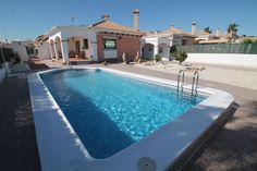 """Property Ref: W4011 Beautiful South facing detached villa with large plot & private swimming pool model """"Marina villas"""" for sale in Urb.La Marina. This fully furnished property offers large porch, 3 bedrooms, 2 bathrooms, living/dining room, kitchen, air conditioning, fitted wardrobes, double glazing, car port, satellite dish, fully paved gardens, security grills, outside shed, oil central heating, security grills, electric gates,mosquito nets, fully paved gardens. Quiet location…"""
