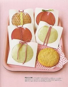 What a cute idea! CD covers for cookie and treat holders, lined in decorative papers!