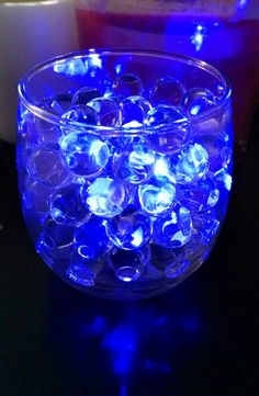 Clear water beads with blue LED submersible tea light. Really pretty for wedding table centerpieces.