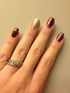 Brown mani with gold dotting and accent nail.