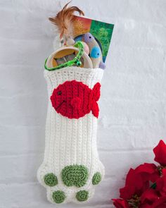 Treat the loveable pet members of your family to some holiday goodies so they'll have their own fun come Christmas morning. This stocking for your kitty is easy to crochet and will complete your group of family stockings.