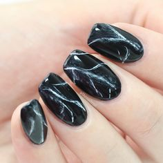 If your entire wardrobe (and outlook on life) is black, these nails are for you.