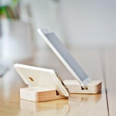 Flaunt your iPhone on your desktop with this super awesome Mini Wooden Stand for iPhone. The wooden design comes with a slot to dock your iPhone. You can use it on your work desk or even on your car.