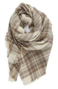 With its classic plaid pattern, fringe trim and soft, lightweight weave, this square scarf has it all, just in time for fall.