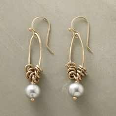 "KINETIC PEARL EARRINGS -- Moving elements create shifting landscapes as circular charms jangle on hammered marquise hoops. Below, a cultured gray pearl falls where it may. By Rebecca Lankford. Handcrafted in USA of 10kt gold. 1-5/8""L."