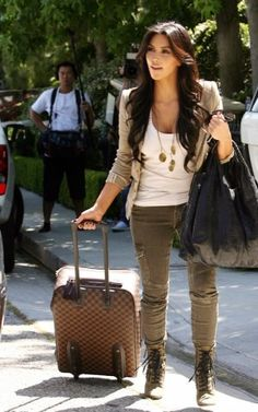 Kim Kardashian wearing Louis Vuitton Pegase Suitcase, Givenchy Large Elschia Bag in Black, Giuseppe Zanotti For Balmain Lace-Up Studded Booties, Elizabeth & James Double Breasted Blazer, Louis Vuitton Pegase Rolling Suitcase in Damier Canvas, Splendid Layers Tank and Current/Elliott the Skinny Cargo Jeans.