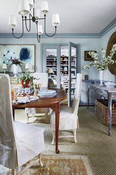 """""""I wanted a jewel box feeling in here, so I went with pale blue walls and a tonal trim,"""" says Seabrook about the flat-finished walls (Benjamin Moore's Woodlawn Blue) and slightly contrasting trim in eggshell (Benjamin Moore's Wedgewood Gray). Benjamin Moore Wedgewood Gray, Blue Grey Walls, Wooden Counter, Farmhouse Style Kitchen, Southern Living, Southern Charm, Southern Style, First Home, Dining Chairs"""