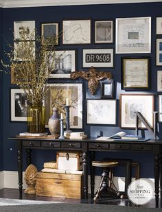 Wall gallery from Pottery Barn. Maybe someday I will be brave enough to paint a wall that dark blue.