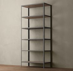 Vintage Industrial Bookcase, Restoration Hardware.  Modern-minimalist if I've ever seen it.  I guess the books bring the vintage here :)