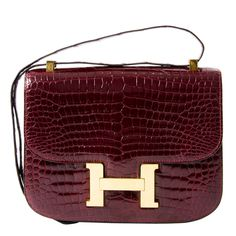 Hermes Croco Constance Rouge H   From a collection of rare vintage crossbody bags and messenger bags at https://www.1stdibs.com/fashion/handbags-purses-bags/crossbody-bags-messenger-bags/