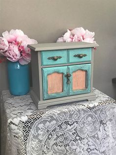 Cute distressed shabby chic jewelry armoire. Features velveteen lining with earring storage, necklace, bracelet and ring storage. Hand painted and sealed item distressed with brass pulls.