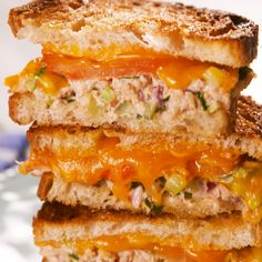 Tuna lovers! Meet your ultimate sandwich. With just the right amount of crunch, melty cheddar cheese, and a couple good slices of tomato, you might even convert a tuna hater. Get the recipe at Delish.com. #delish #easy #recipe #tunamelt #sandwich #cheddar #best #classic #pickles #seafood #tuna #comfortfood