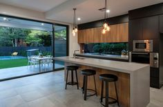 Macrocarpa wrapped kitchen island with single waterfall edge 8 Amazing Kitchens featuring Caesarstone Concrete Designs