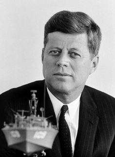 John F. Kennedy, 1961- Elliott Erwitt. The replica of PT 109 is of the PT boat commanded by Lieutenant John F. Kennedy during World War II.