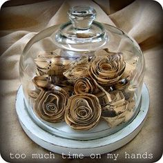 Cloche with sheet music roses inside. by jessicaj
