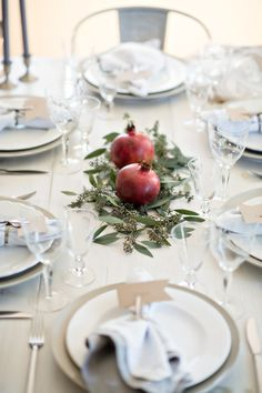Pomegranate and eucalyptus centerpiece from How to Set an Intimate Rosh Hashanah Table | Chai & Home