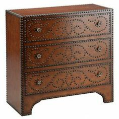 """3-drawer chest with antiqued brass nailhead accents and a scroll-inspired motif.    Product: ChestConstruction Material: Wood and metalColor: Brown and antiqued brassFeatures:  Nailhead accentsThree drawers Dimensions: 30"""" H x 30"""" W x 14"""" D"""