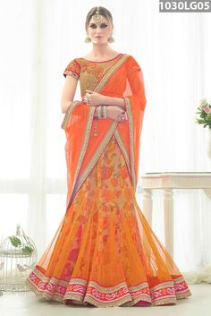 Orange net lehenga with floral printed lining designed with stone, zari, resham embroidery, lace and patch border work. Beige, pink art silk jacquard and net choli and orange net dupatta are available with this.Price US$ 167