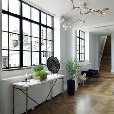 Black steel frame windows in loft, Lindsey Adelman fixture
