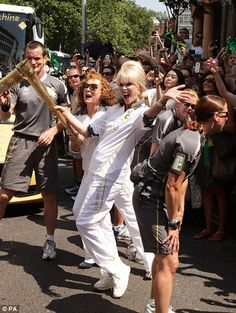 Absolutely Fabulous! Striking a pose: The comedy stars went for a jaunty walk with the torch