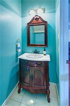 The bathroom under the stairs, beautifully updated, just needs a different color on the walls.