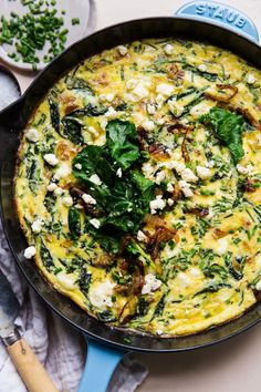 A silky pour of heavy cream helps this vegetable-laden frittata stay tender, light and bouncy, even as we load it up with rich caramelized onions, tangy feta and a veritable garden of baby kale.