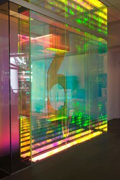 Bloombery executive offices, NYC Dichroic acrylic floor to ceiling screens divide the space and give an airy feel