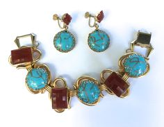 Mid Century Art Glass Demi Parure Bracelet and Earrings by WhirleyShirley on Etsy https://www.etsy.com/listing/248743309/mid-century-art-glass-demi-parure