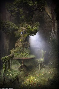 Incredible: The scenes are just 12 inches high but contain incredible detail like this giant tree, chairs and table