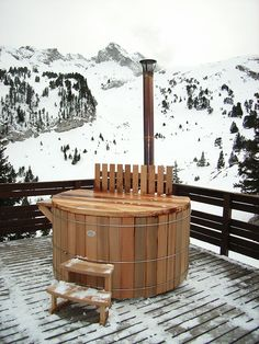 wooden jacuzzi outside in the snow... amazing feeling... cold air, hot water