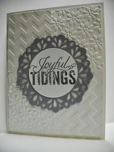 Chevron & Petals-a-Plenty embossing on Shimmery White card stock with Brushed Silver Delicate Doilies Christmas Messages medallion