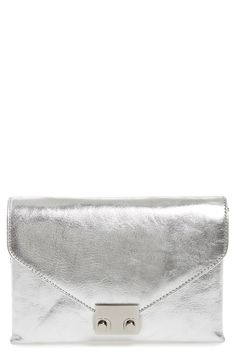 acb7eb9a905d Falling fast for this silver metallic leather clutch. Perfect for adding  some shine to any