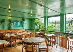 Quirky-Chic Amsterdam Restaurant Brings Elements of Rainforest Indoors - Curbedclockmenumore-arrow : Highly stylized and oh-so cool