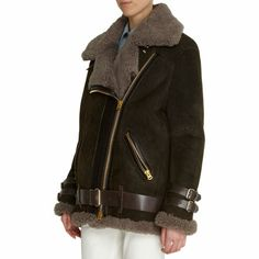 Acne Studios Velocite Coat at Barneys.com Suede lamb leather oversized moto jacket with shearling inside lining, collar, cuffs, and hem. Leather belted waist, cuffs, placket, and throat latch. Front diagonal zip pockets. Gold-tone hardware throughout. Available in Peat Green. Imported. Leather.